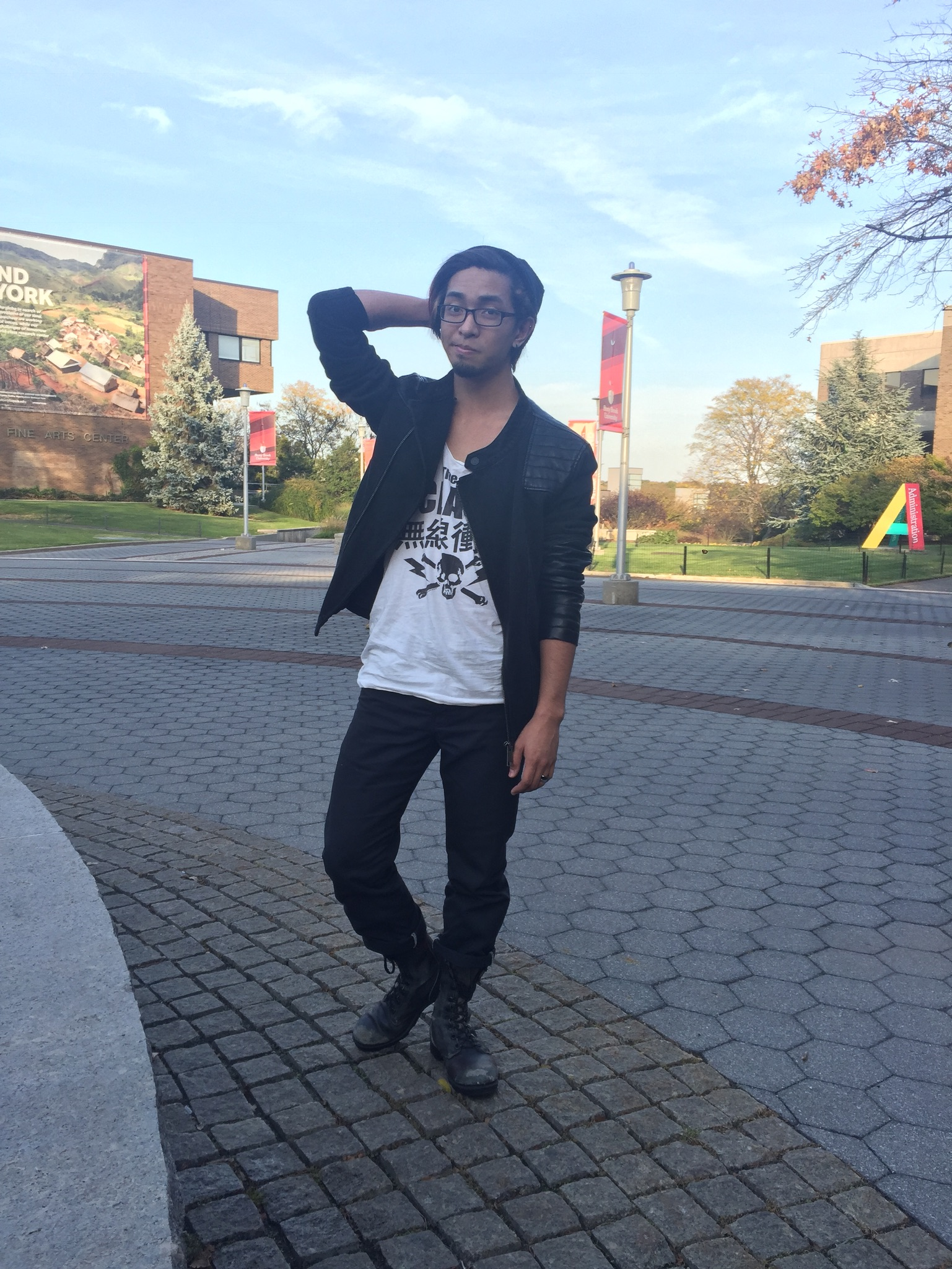 """Geremi Mataban, senior psychology major. """"I like wearing and layering jackets because with New York weather, you never know how hot or cold it's gonna get throughout the day so I can just put them on or take them off."""" CHEREESE CROSS/THE STATESMAN"""